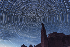Figure 3-7: Star trails over the Titan, Fisher Towers, Utah. August 10-11, 2016, 9:44 p.m. to 3:28 a.m. Canon EOS 1Ds Mark III, Canon EF 16-35mm f/2.8L II USM. Land: 6 seconds, f/11, ISO 200 (shot at 8:33 p.m., 18 minutes after sunset). Sky: 339 frames, 59 seconds, f/2.8, ISO 200.